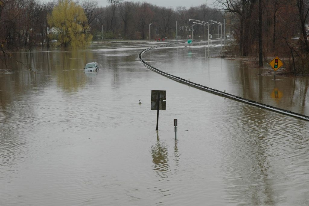 Road sign under water due to a flood